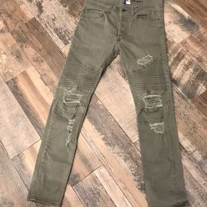 Divided skinny khakis with ripped knees
